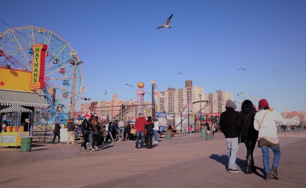 coney island boardwalk and ferris wheel