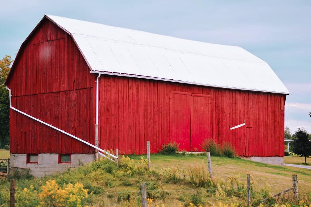 bright red barn in a field